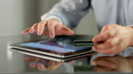 Male hands booking tickets, paying bill online on tablet PC video