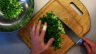 Male hands chopping green video