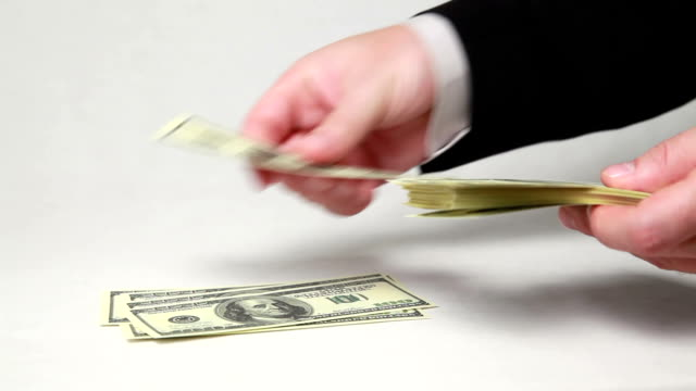 Male hands counting money on white background. video
