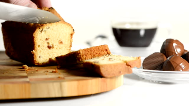 Male hands cut cake with raisin on a chopping board a sharp knife video