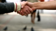 Male hands giving the keys to car to his friend. Handshake between two men outdoor.Male hands giving the keys to car to his friend. Handshake between two men outdoor. video