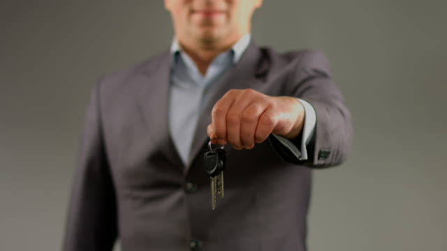 Male hands hold keys. Renting car, apartment, real estate agent video