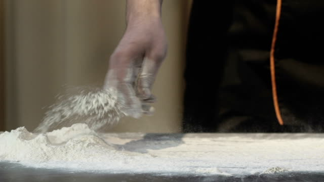 Male hands kneading dough video