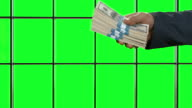 Male hands passing dollars. video
