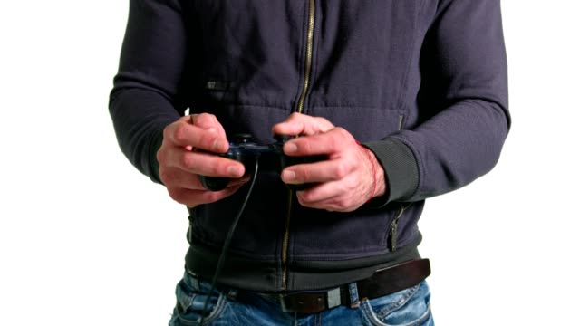 Male hands playing video games with gamepad, joystick or controller on slow motion video