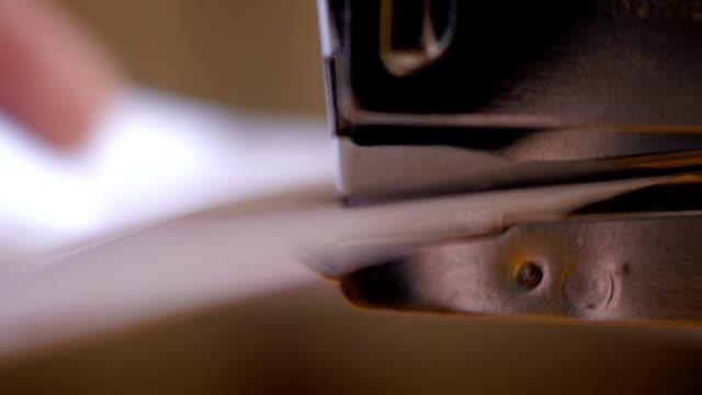 Male hands using paper stapler video