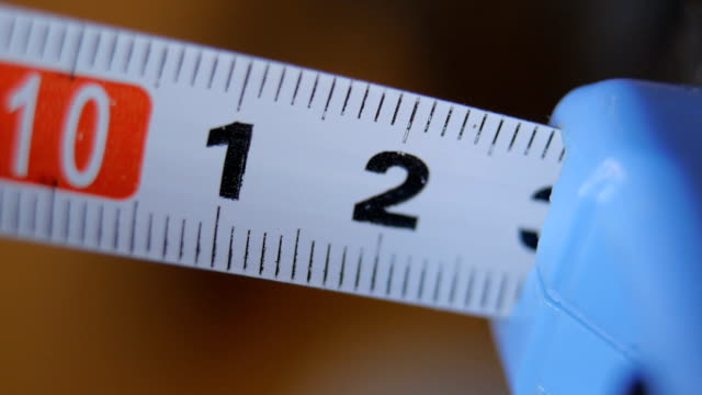 Male hands using tape measure video