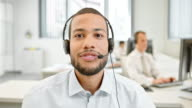 LD Male helpline operator on video call with customer video