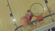 Male high school basketball player racing for a layup at the hoop video