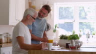 Male Homosexual Couple Having Breakfast At Home Together video