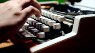 Male human hands write with an old fashion typewriter machine video