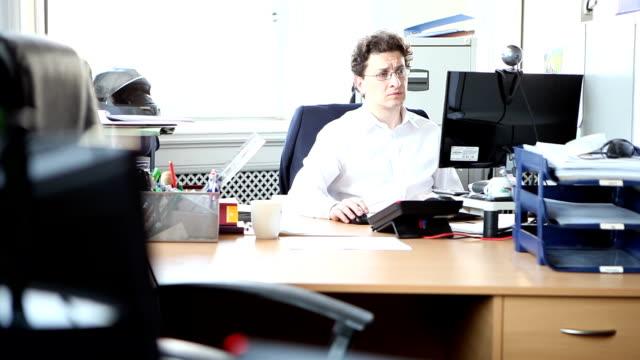 Male lawyer sitting in office video