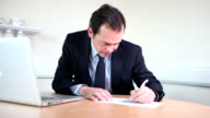 Male lawyer writing report video