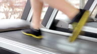 Male legs during workout in the gym, man running on video