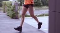 SLO MO TS Male legs running along a city street video