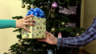 male man hand give present gift box with ribbon for female woman video
