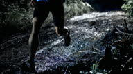 SLO MO DS Male marathon competitor running on a muddy trail at night video