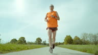 SLO MO TS Male marathon runner running in countryside video