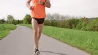 SLO MO TS Male marathon runner running on sunny day video