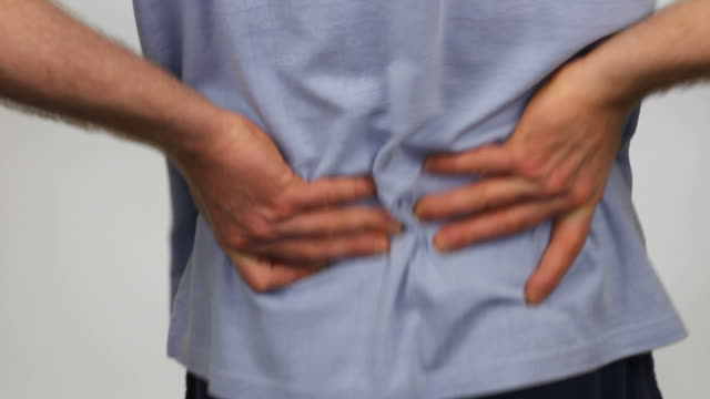 Male Massaging His Back Pain for Relief video