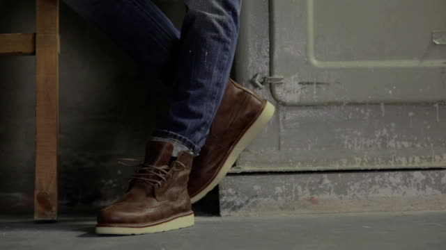 Male model in brown shoes video