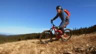 SLO MO Male mountain biker riding down mountain trail video