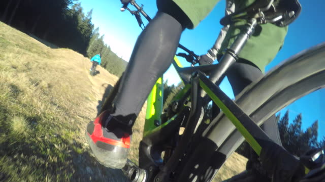POV Male mountain biker riding down the trail video