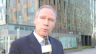 Male news reporter on location video