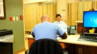 Male nurse at nurses station video