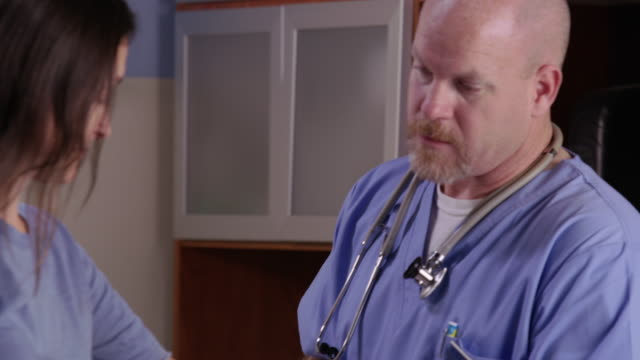 Male nurse check patient's blood pressure video