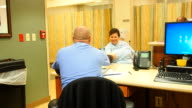 Male nurse discharging patient video