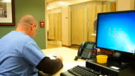 Male Nurse doing paper work video