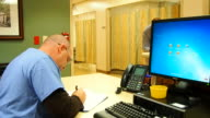 Male nurse doing paperwork video