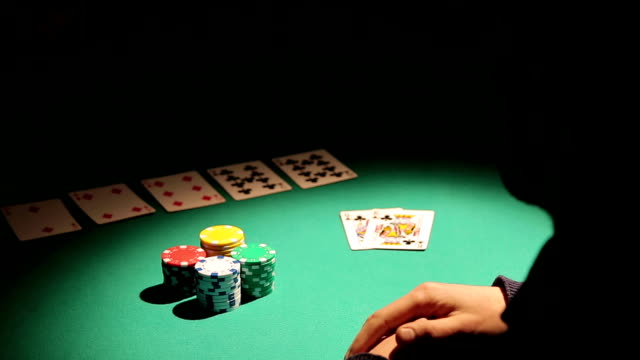 Male obsessed with gambling losing all money in poker game, video