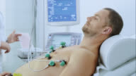 Male patient during the EKG test video