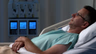 Male patient in hospital bed video