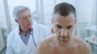 Male patients face while having an auscultation examination by doctor video
