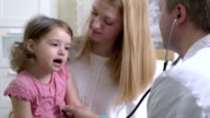 Male pediatrician examines baby with a stethoscope. video