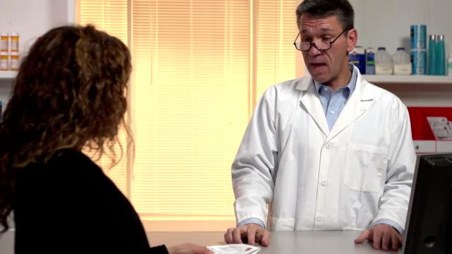 Male Pharmacist explaining to patient about the prescription drug video