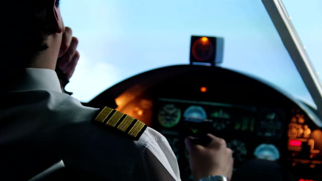Male pilot flying in autopilot mode, transmitting information by walkie-talkie video