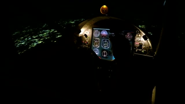 Male pilot hands holding steering wheel, preparing plane for landing at night video