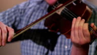 Male plays violin performing at classical concert, music event video