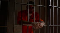 4K Male Prisoner in Jail Cell with leaning on the bars video