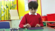 Male Pupil Working With Shapes At Desk video