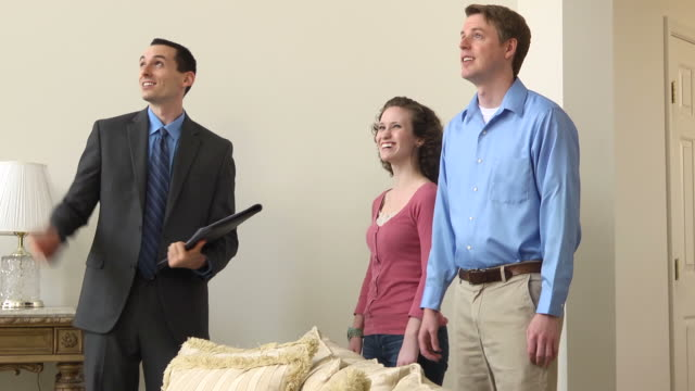 Male Real Estate Agent Showing Home - MS video