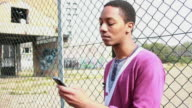 Male receiving text message on mobile phone video