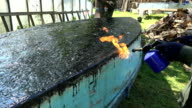 male repair surface burner fire resin in construction site video