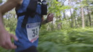 TS Male runner competing in marathon through forest video