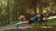 DS Male runner doing pushups on a park bench video