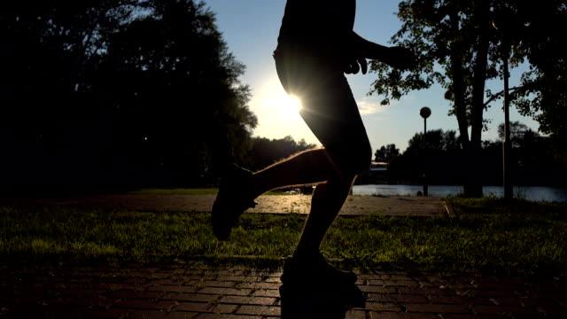 Male runner legs sunset silhouette. FullHD steadicam video video